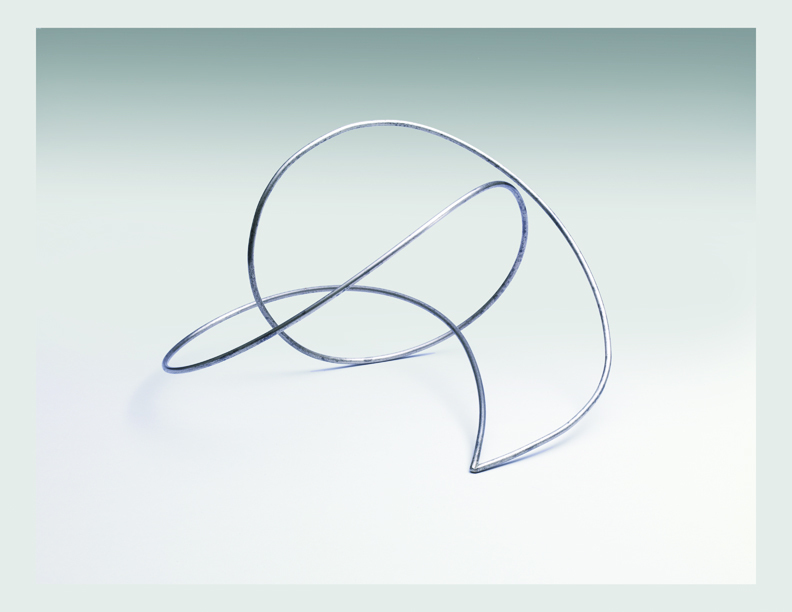 """Photo of """"La Linea Continua (Continuous Line)"""" by Enio Iommi a sculpture where a stainless steal bar loops around and through itself before connecting to a point a the base"""
