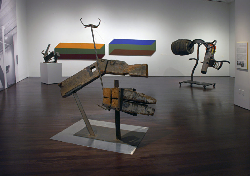 View inside the Reimagining Space exhibition, several artworks are hung on the walls and sculptures are displayed on the floor