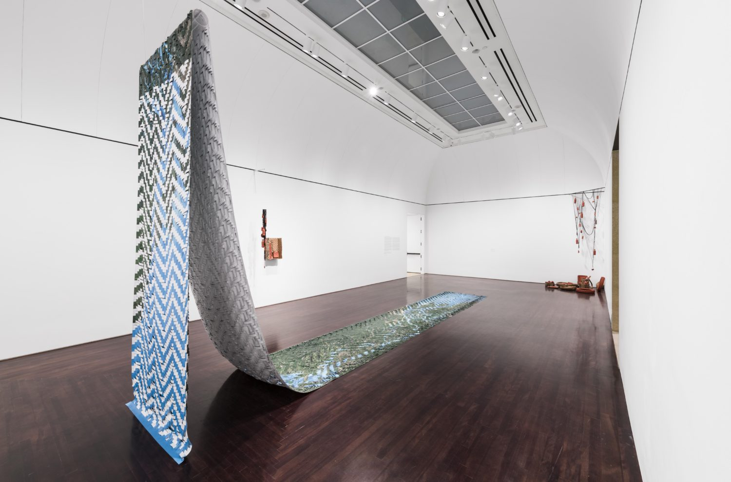 """Artwork by Clarissa Tossin, titled """"Meeting of Waters"""", a fifty-foot woven tapestry that depicts the confluence of two rivers"""