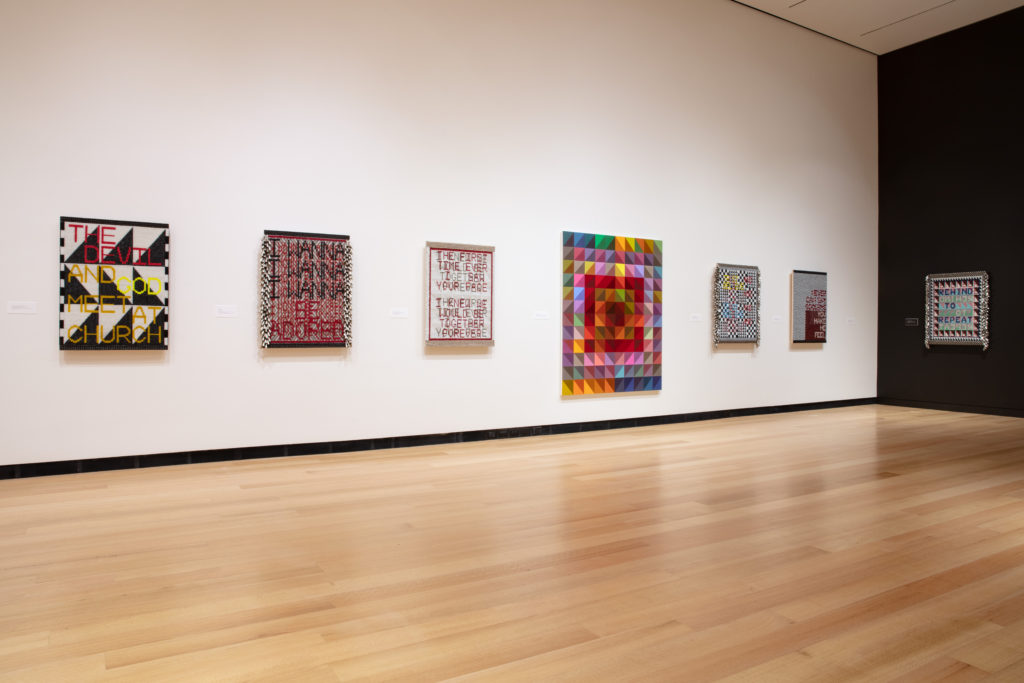A view of seven Pieces by Jeffrey Gibson, including I WANNA BE ADORED.