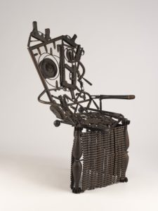 Chair made out of welded weapons and ammunition