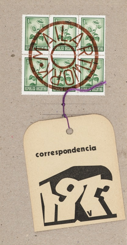 """Image depicts a brown postcard with six green Argentinian stamps, in two rows of three. The stamps are cancelled with a large circular stamp that reads """"Mail Artwork."""" Attached to the card via a length of string is an off-white tag that reads """"correspondencia."""""""