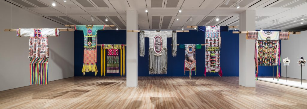 Exhibition view of Jeffrey Gibson: This Is the Day featuring his large scale garments